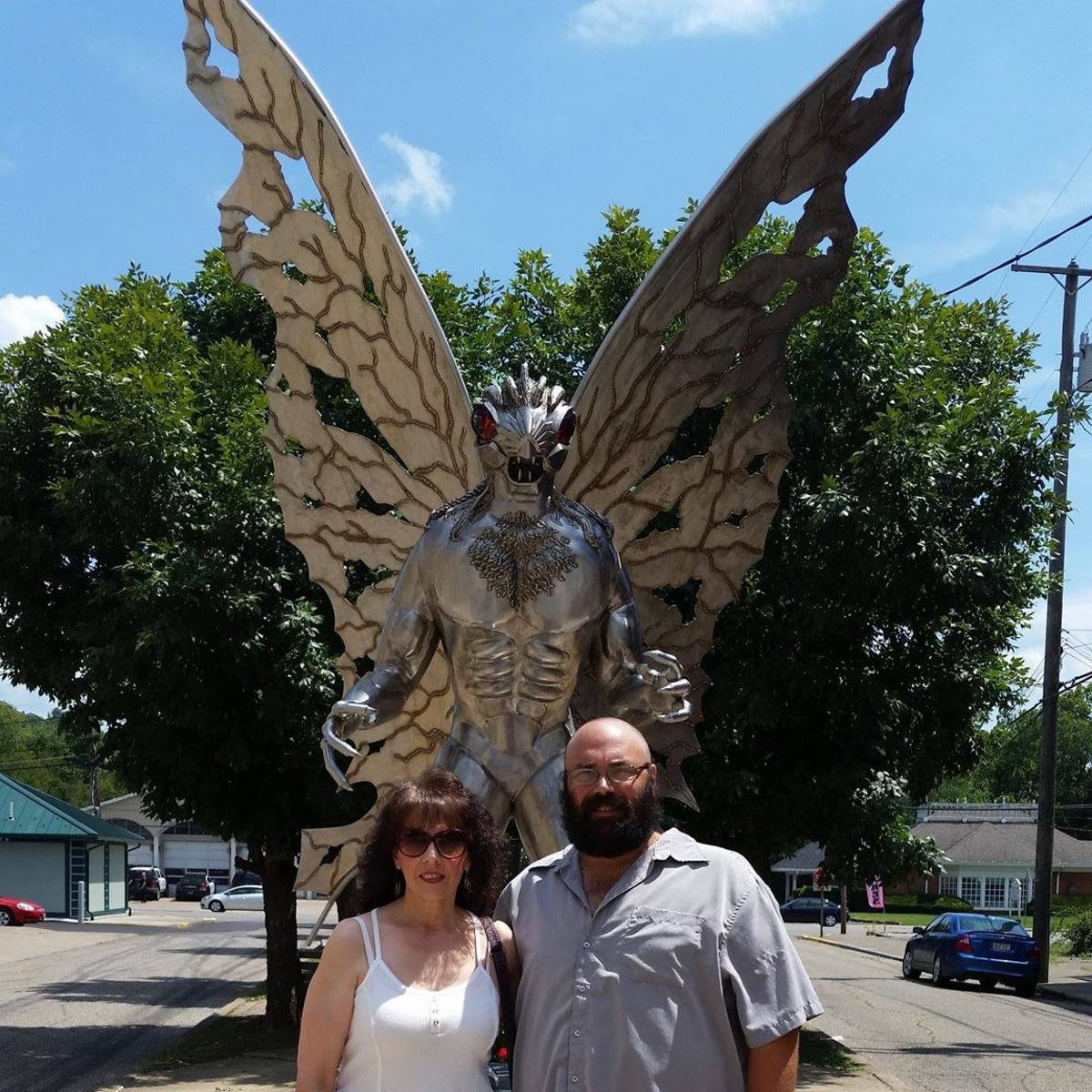 My husband and me in front of the Mothman statue located in Point Pleasant, West Virginia.