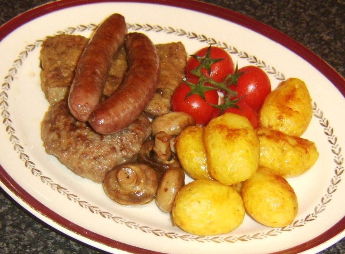 Fried ox liver is served with beef sausages, a homemade beef burger, deep fried potatoes, tomatoes and mushrooms