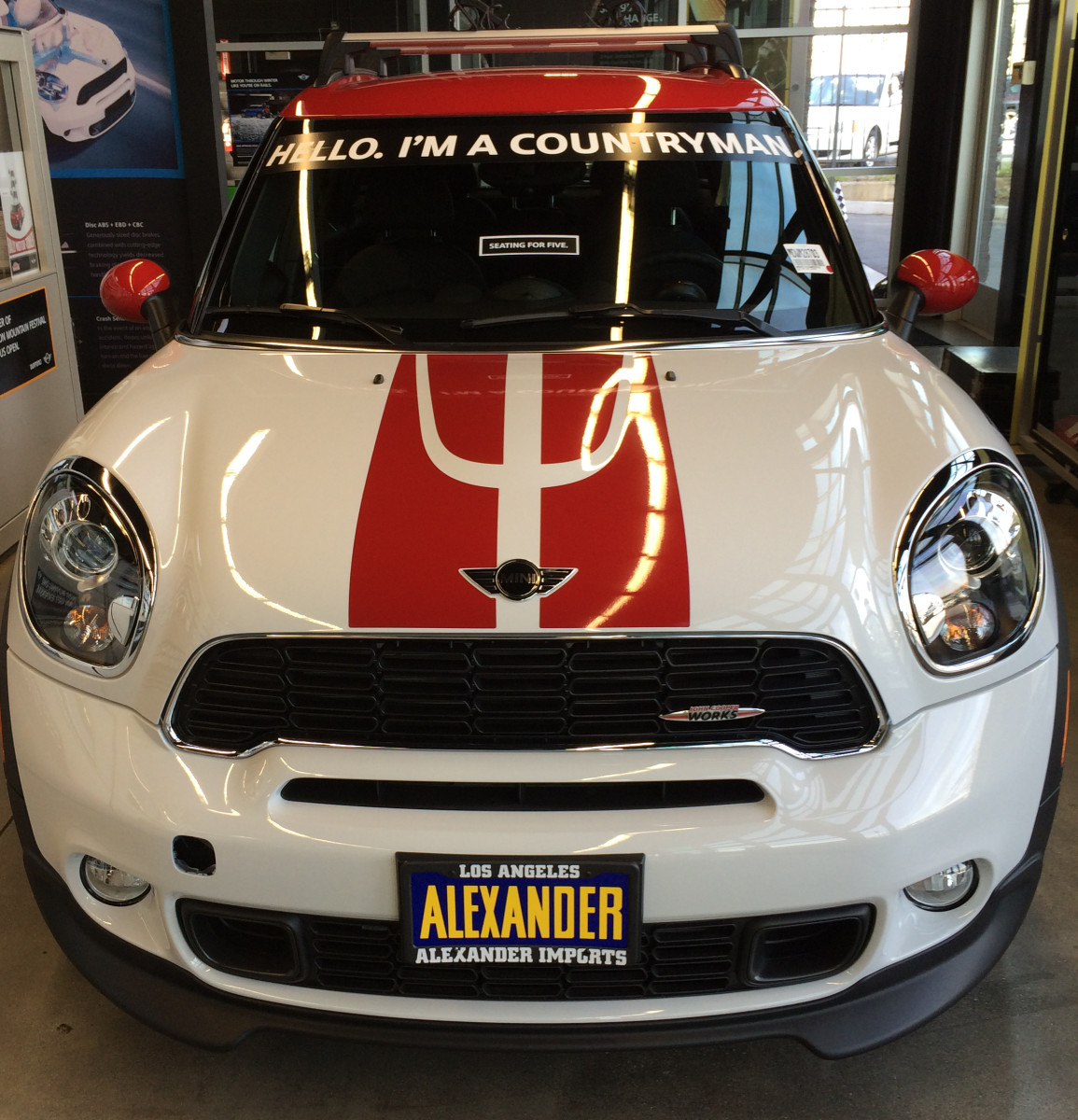 A highly customized MINI Countryman in the showroom of a dealership.