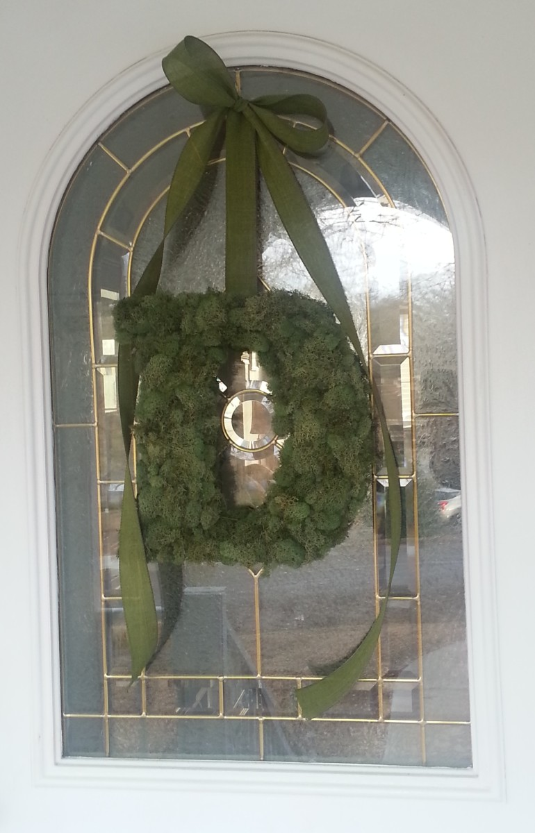 Moss covered monogram / wreath hanging on my front door.
