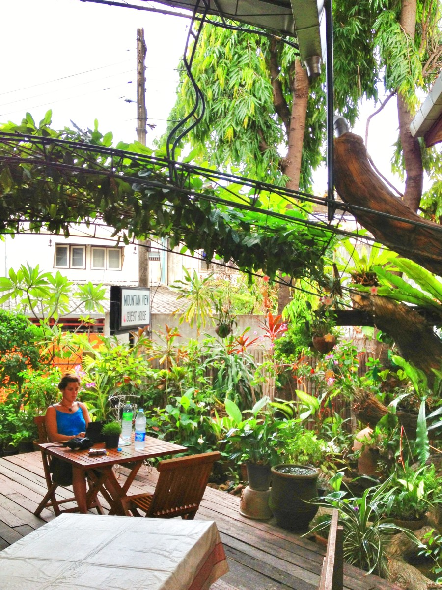 Open air seating in the dining area of Mountain View Guest House in Chiang Mai.