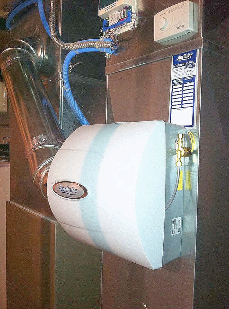 Run a test cycle and replace the cover. Your humidifier installation is done if the test cycle was good.