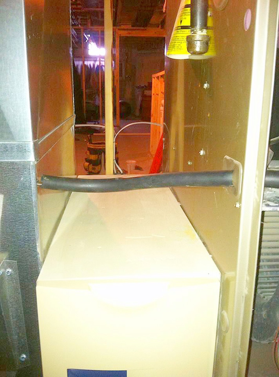 Here, I protected my wiring from the duct to the furnace.