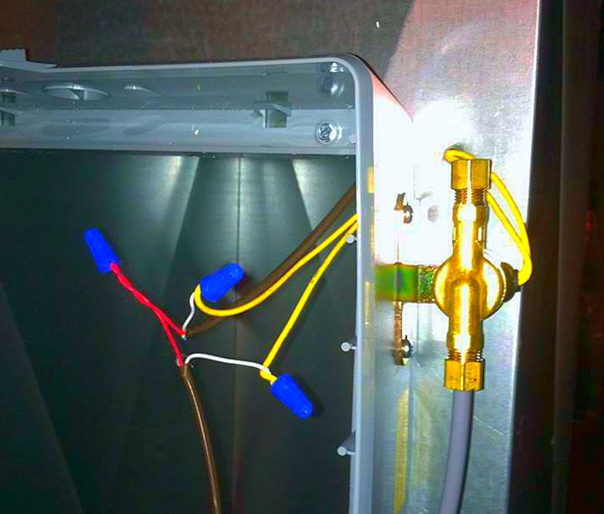 I poked a hole in the duct & inserted the wires from the humidifier to hide my connections. White from humidistat to AprilAire unit and from  AprilAire unit back to the transformer. The red is just a continuation from transformer to humidistat.