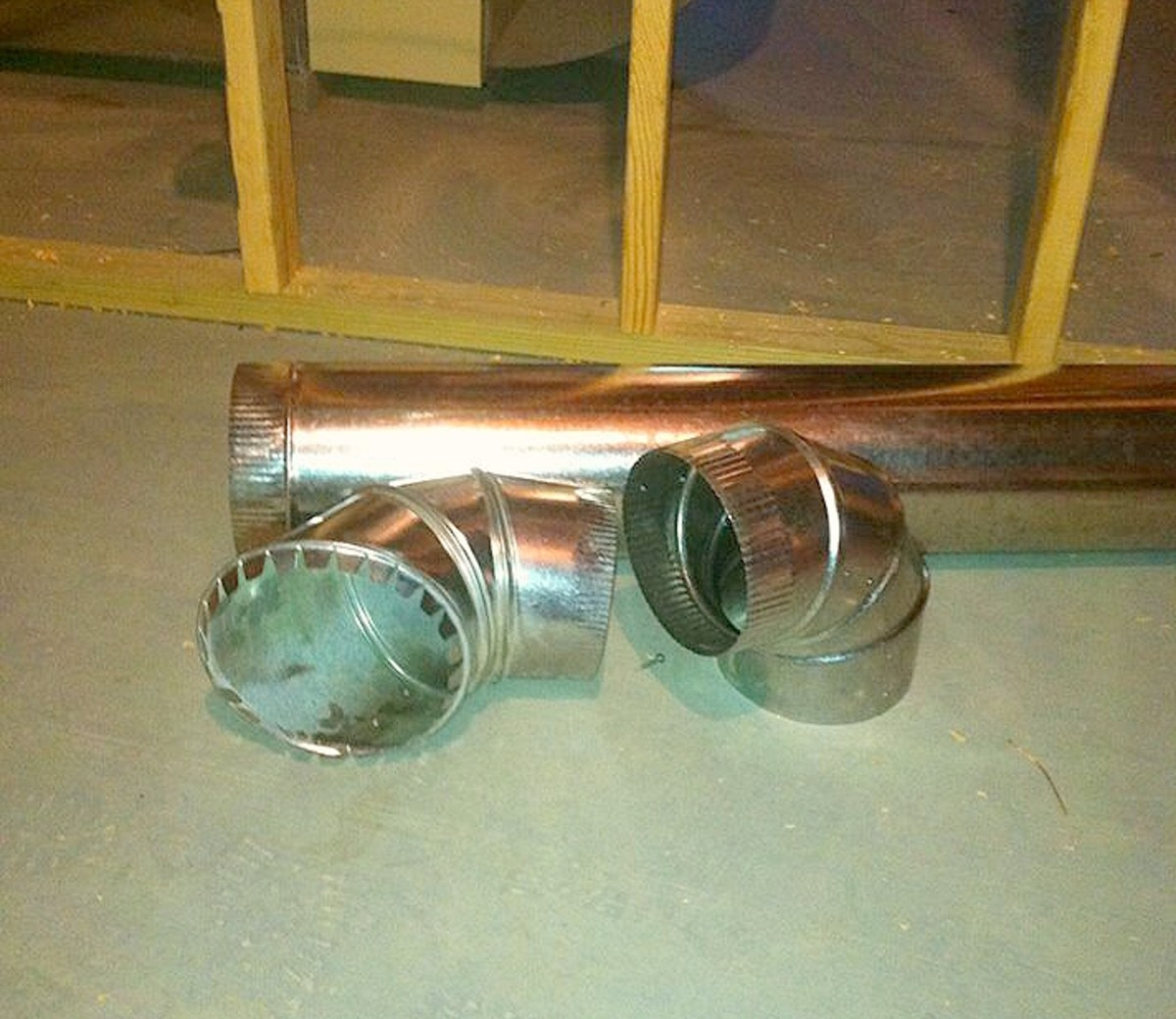 "A 6"" warm air pipe and fittings—the take off is on the left, the elbow on the right, and the pipe at the back."