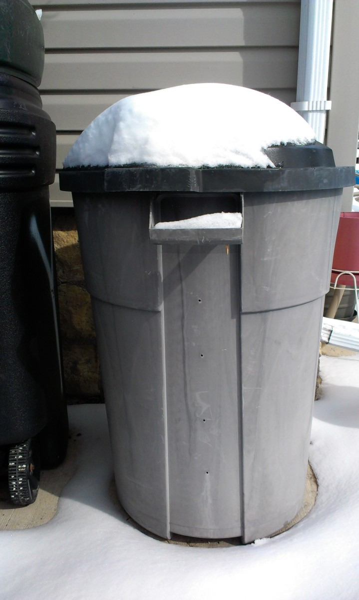 My homemade compost bin made out of a garbage can with a locking lid.