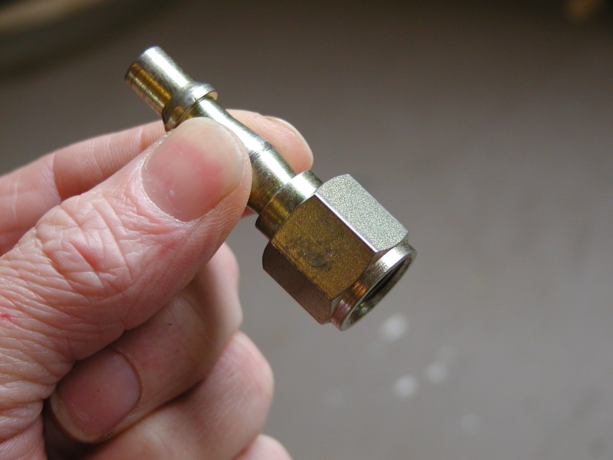 1/4 inch BSP quick release bayonet adaptor with female threads.
