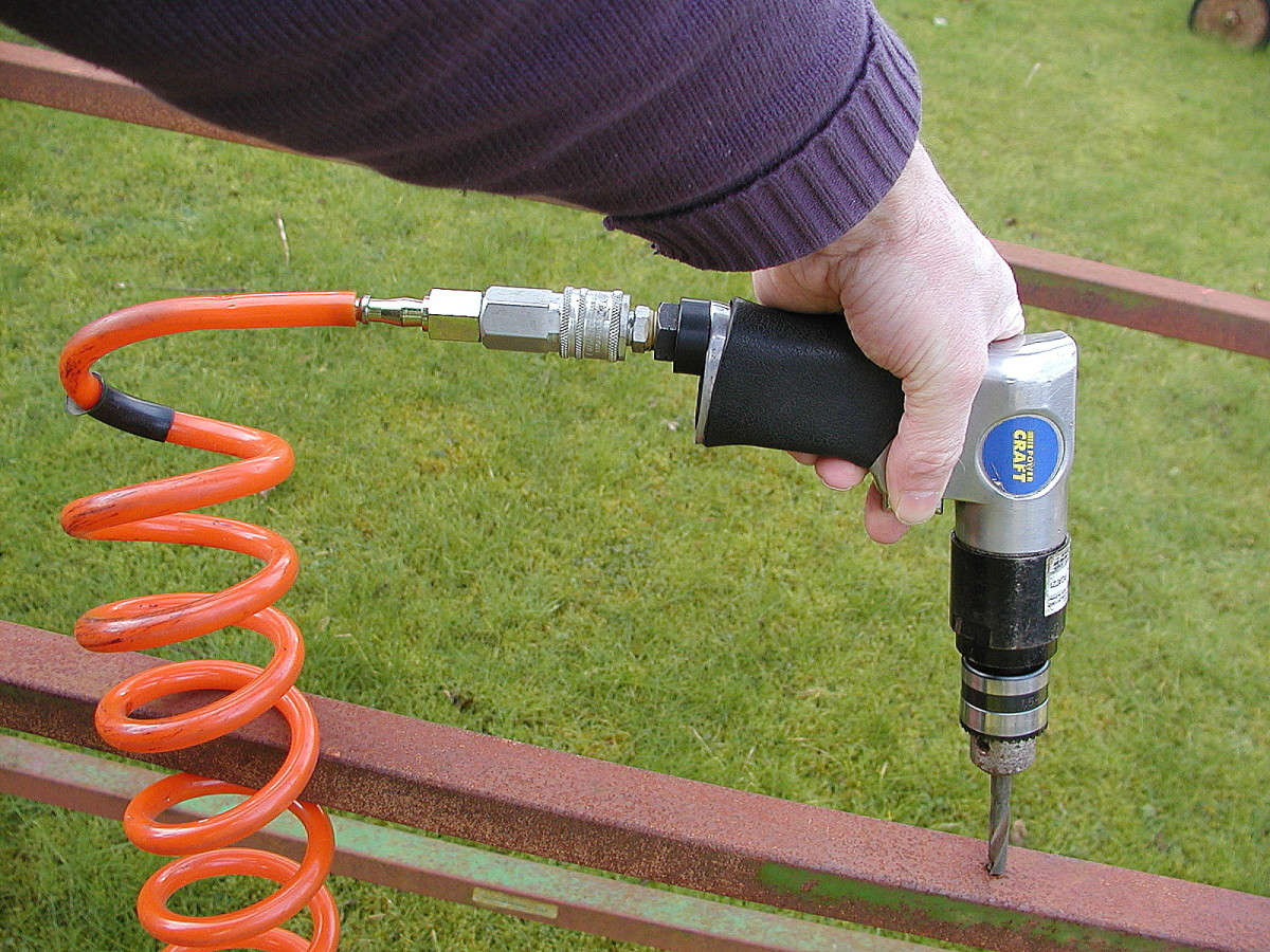 Air drill with coiled air hose.