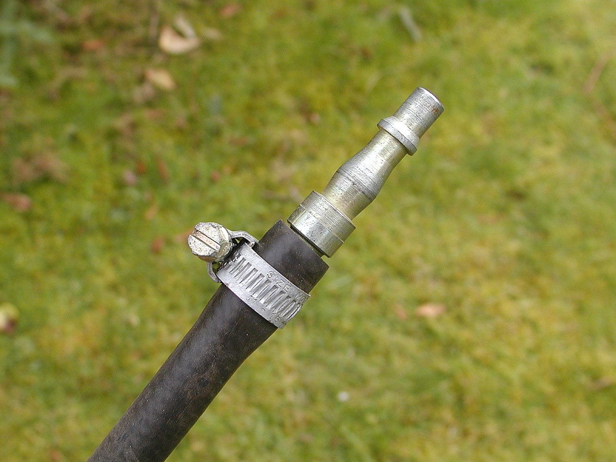 Push the clip so that it lies halfway along the barb, and tighten with a screwdriver.