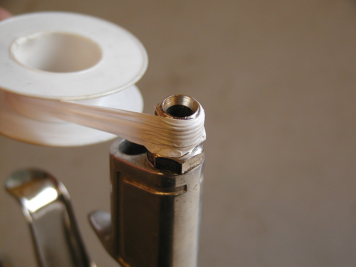 Wind the PTFE tape tightly in a clockwise direction down the length of the threads. Apply a few layers of tape