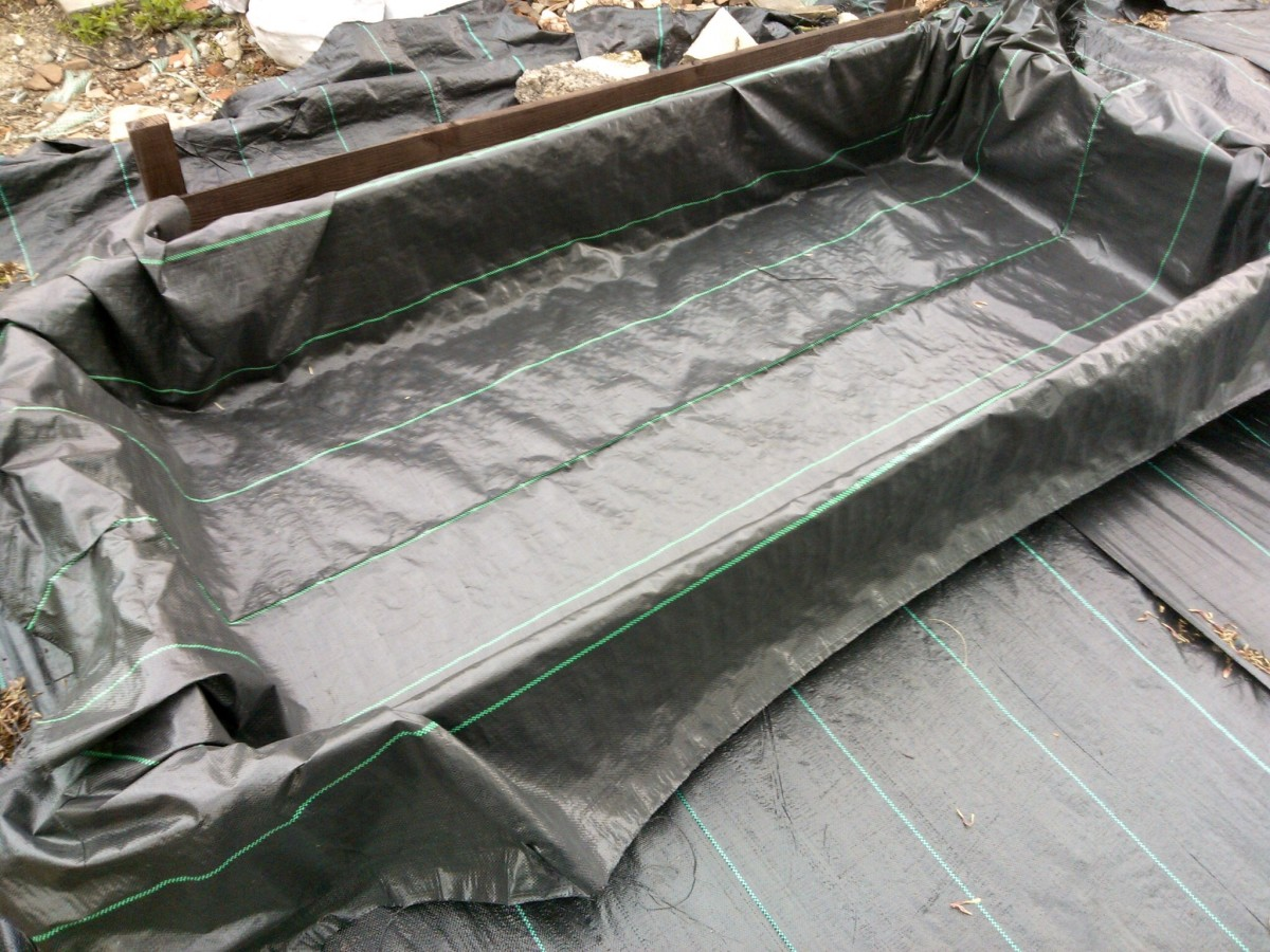 Lining raised beds stops soil leakage and makes them last longer.