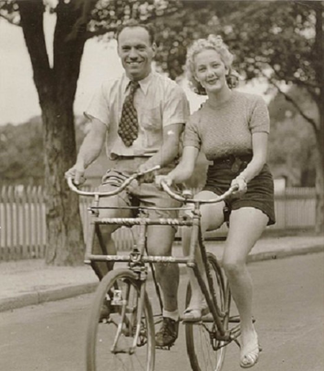 Man and woman on a Malvern Star abreast tandem bicycle around 1930.