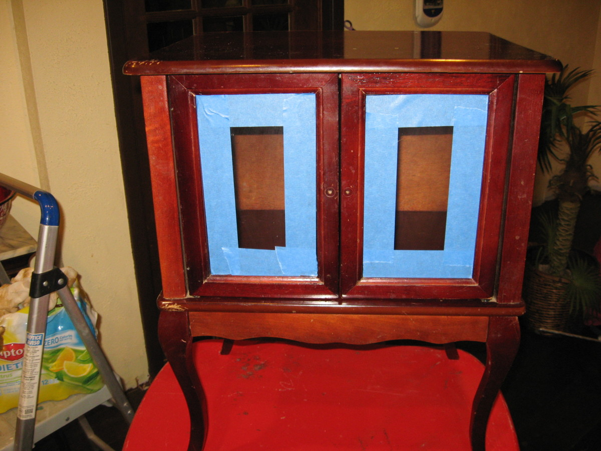 Before photo, with painter's tape around glass.