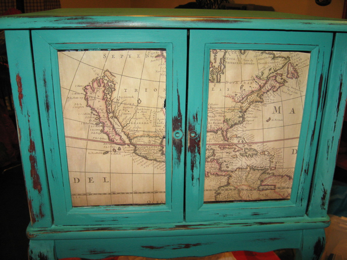I decoupaged an old map to the doors.