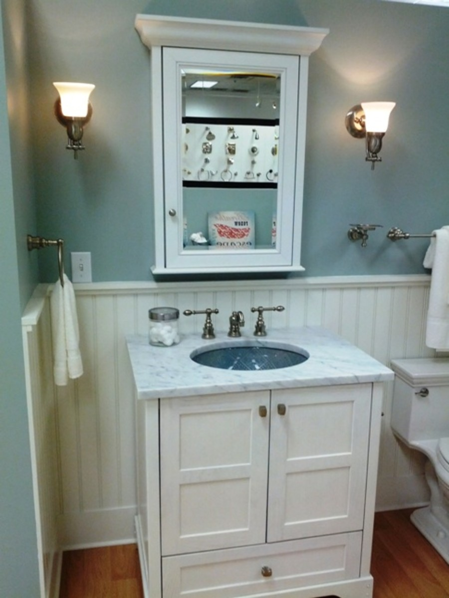 White wainscoting is another design technique that is coming back. Freestanding sinks are an option that is inexpensive but also takes up more space than a free floating sink.