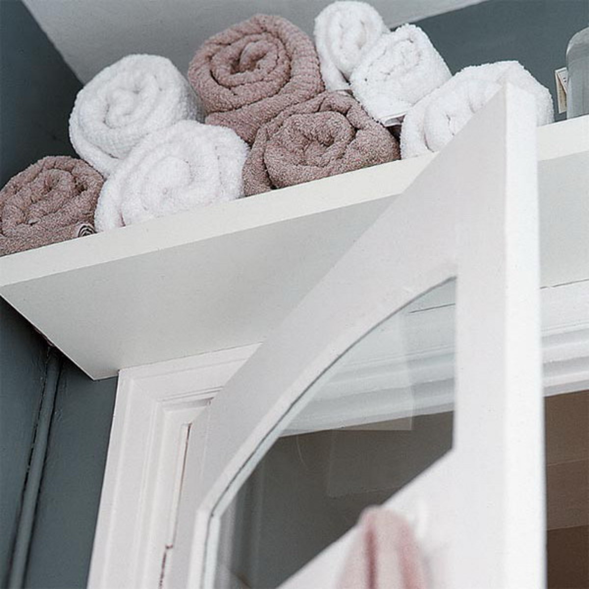 Shelf space is always key in small spaces. Whenever possible free hanging shelves are best to keep things off the floor.