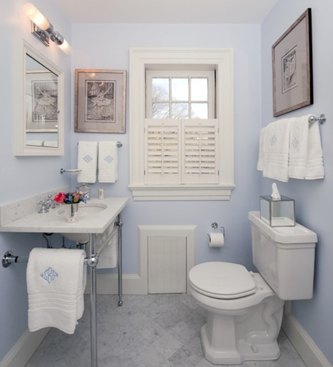 This bathroom is painted in a light blue which allows the light to bounce and reflect off the walls and give you a feel of openness.