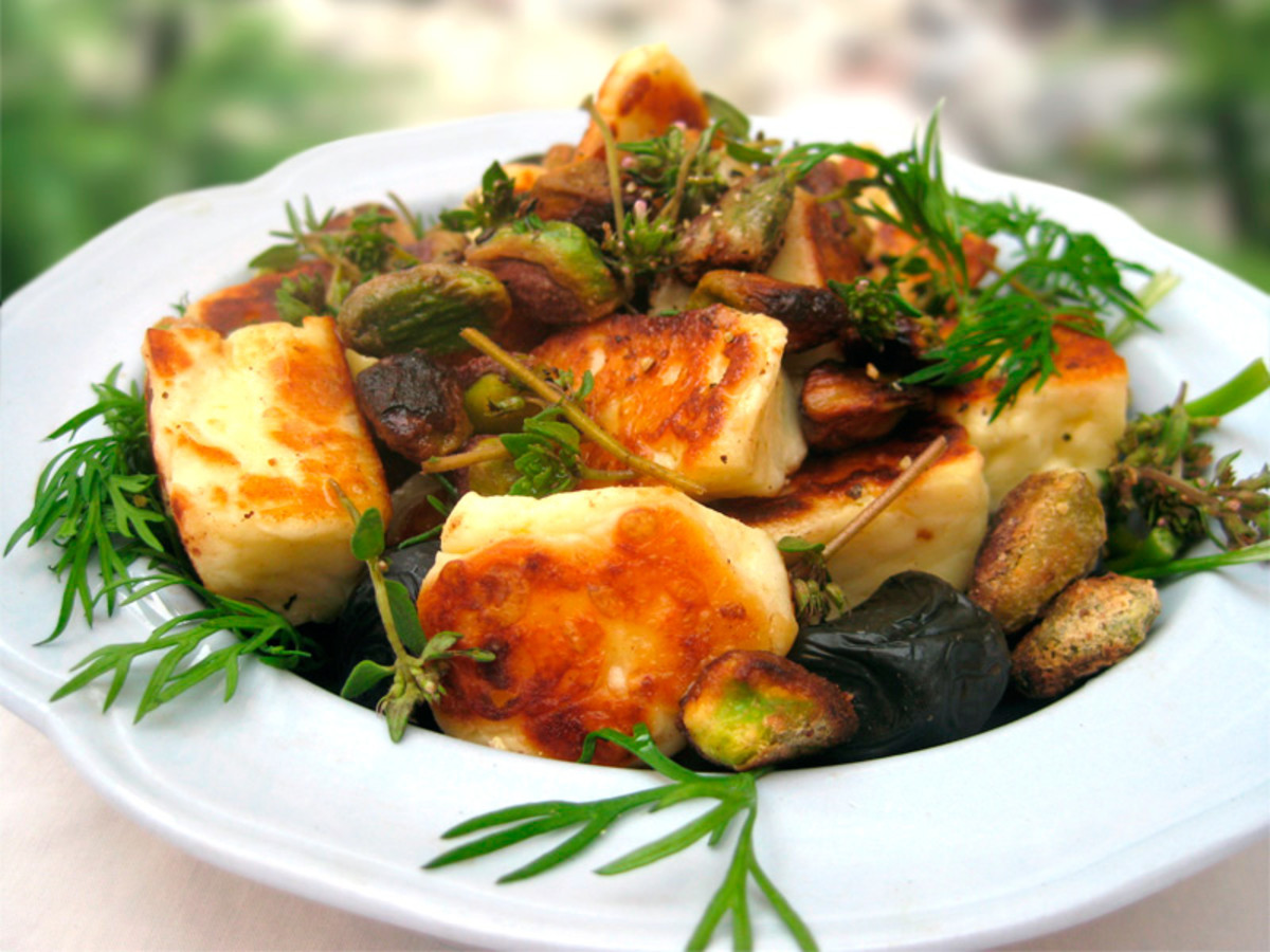 Fried halloumi cheese with dill, thyme, olives and pistachio nuts.