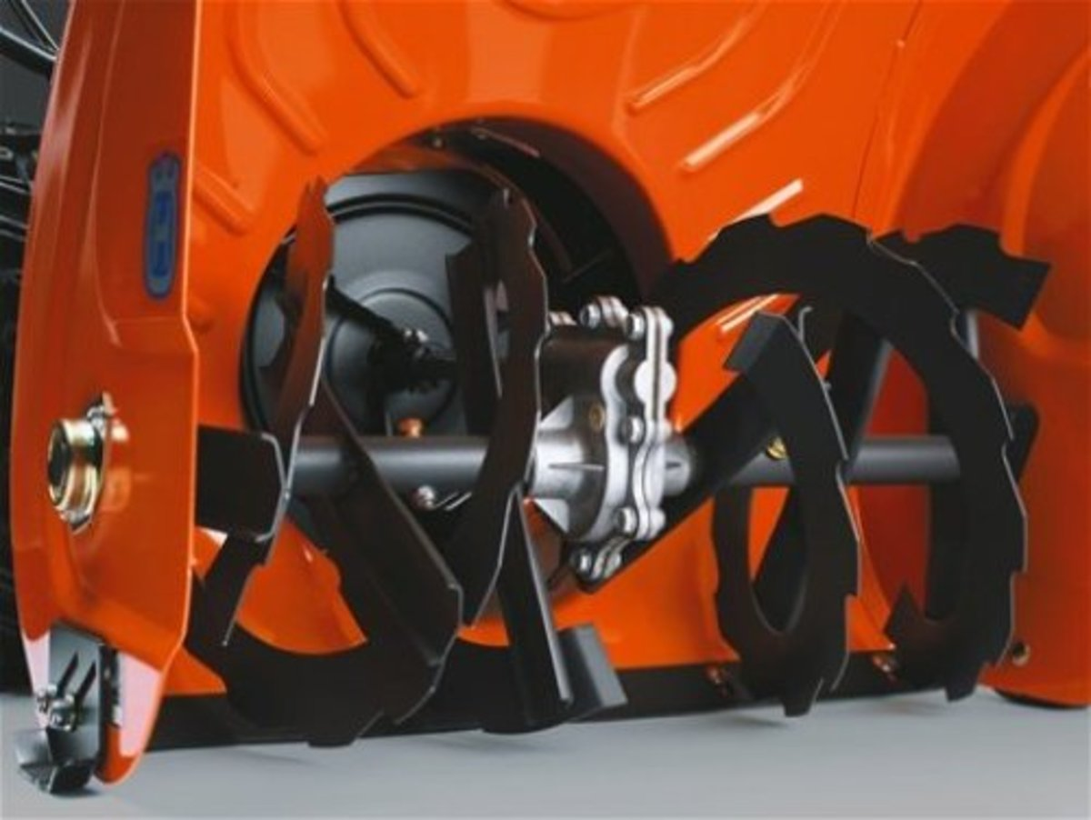A two stage snow thrower has both an auger and an impeller to give it better use in areas where snow may fall at a rapid pace.