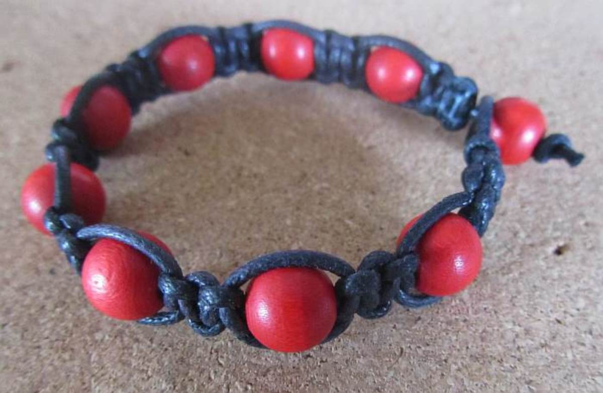 Beaded macramé bracelet created using square knots.