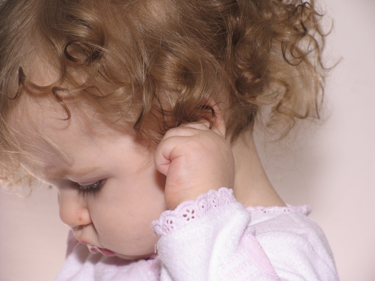 Tugging at the ear could indicate a problem with earwax.