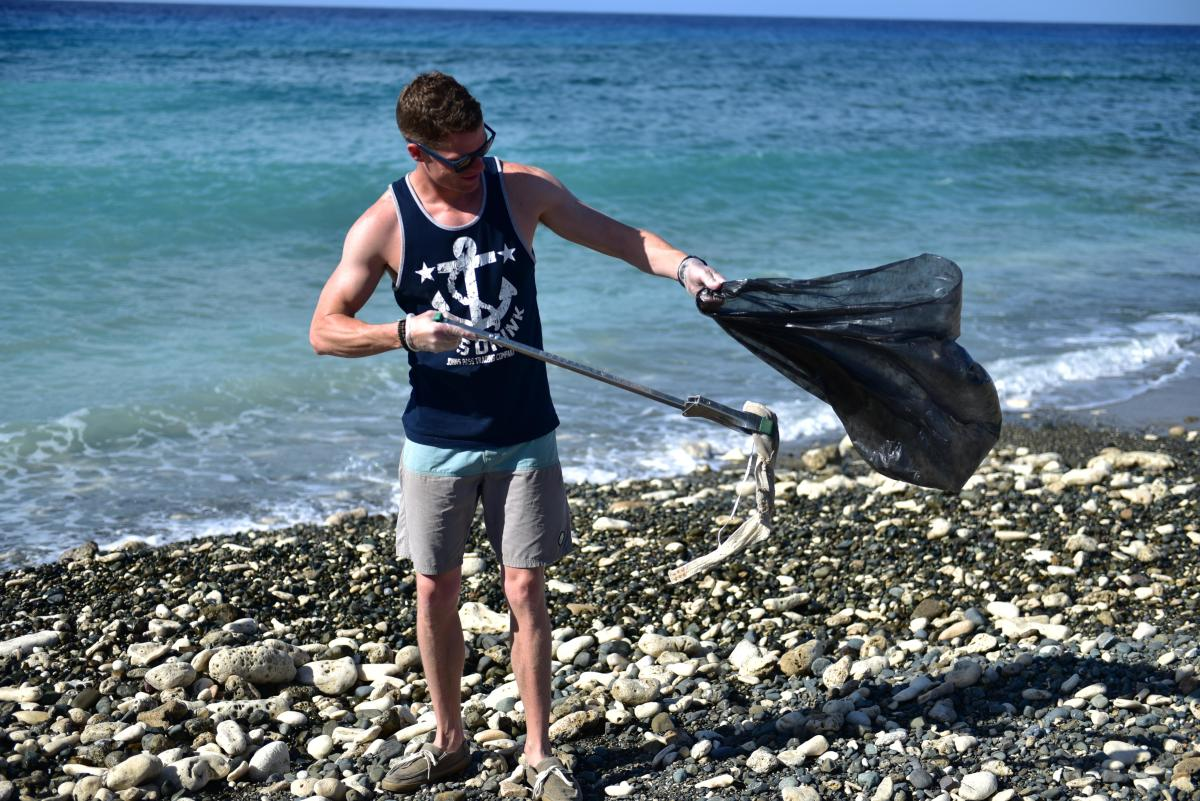 Picking up trash on the beach.
