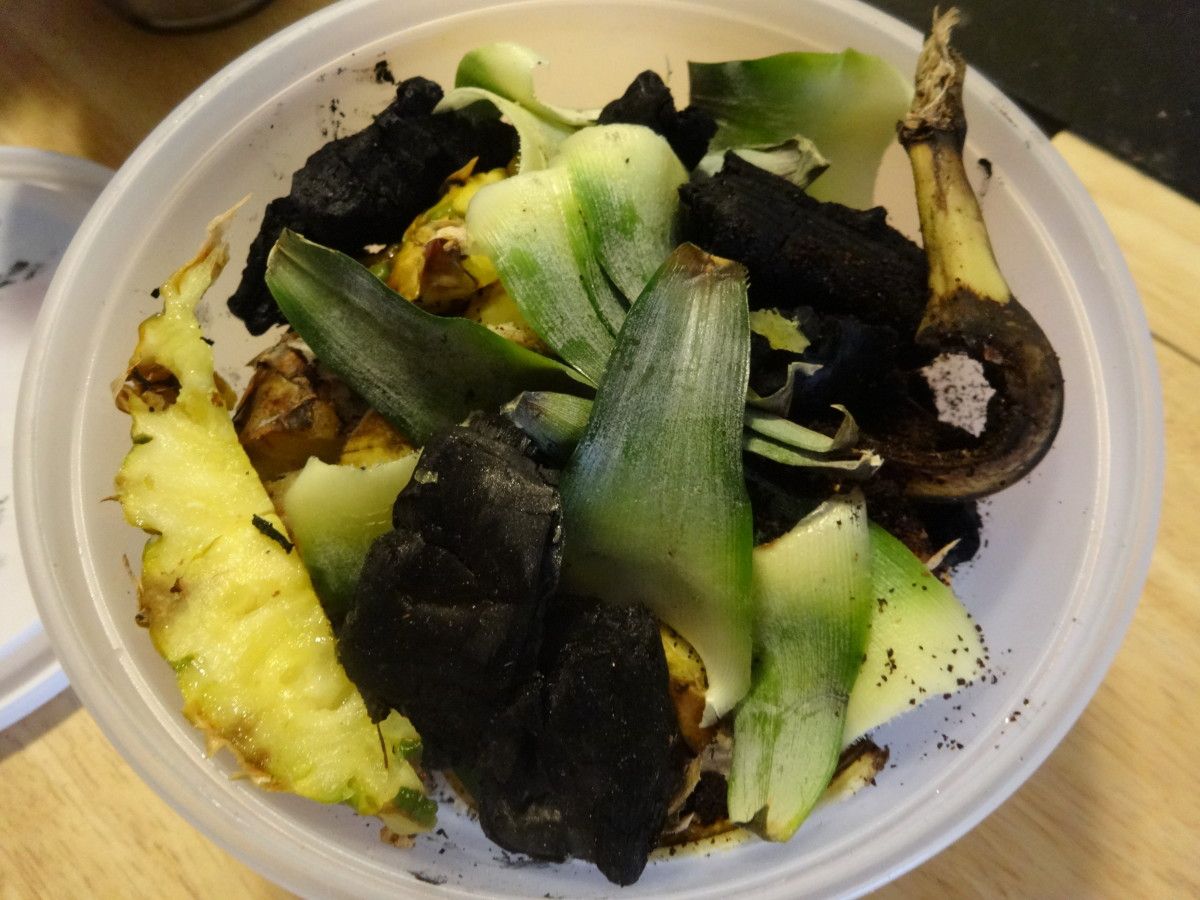 Mixing in charcoal or ash with your compost will help disperse nutrients and balance out any acids added to the mix.