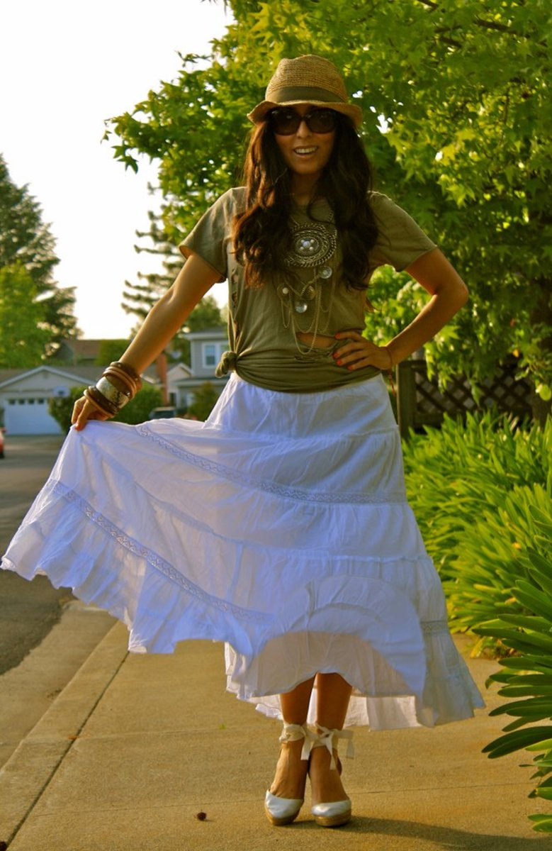 White maxi skirt styled with a t-shirt and a hat.