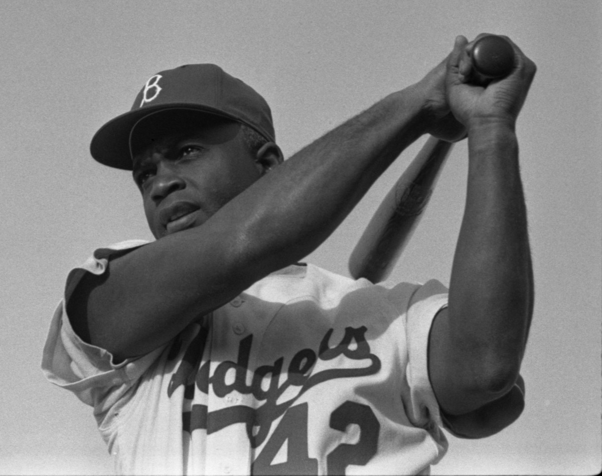 Jackie Robinson, seen above in 1954, was the first African-American player in Major League Baseball. When he broke the color barrier in 1947, he faced harsh treatment from his own teammates, as well as players on opposing teams.
