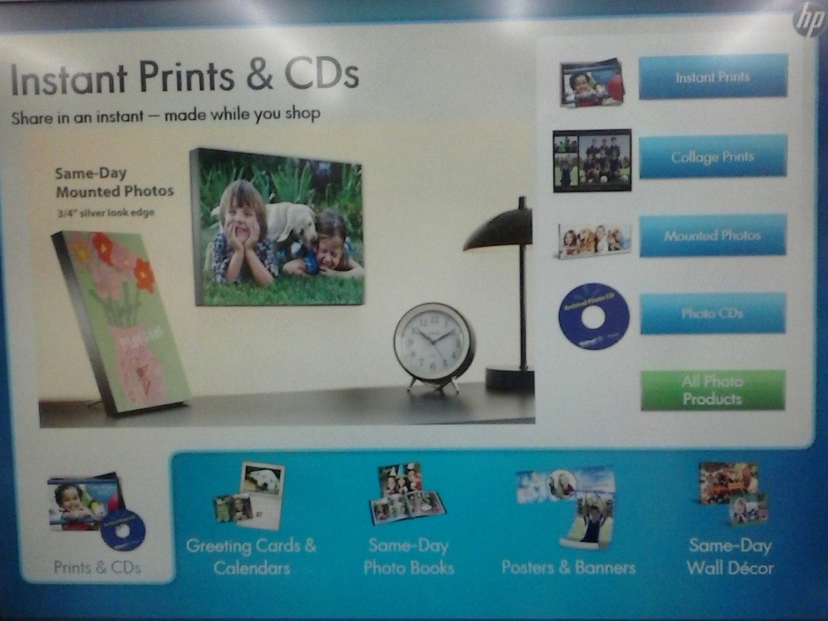 Find the nearest Walmart and set up shop at their Instant Prints kiosks. On the first page, you need to choose the INSTANT PRINTS option.