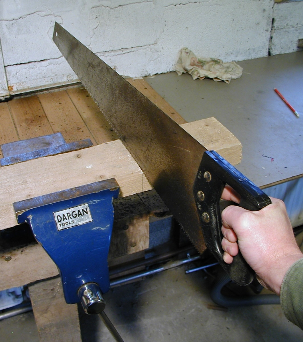 Hold the timber securely in a vice