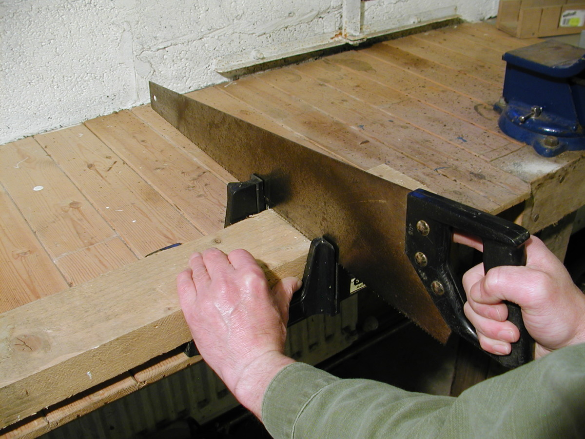 "This miter box has a ""lip"" or hook on the underside which allows it to be pushed tightly against the edge of a bench"