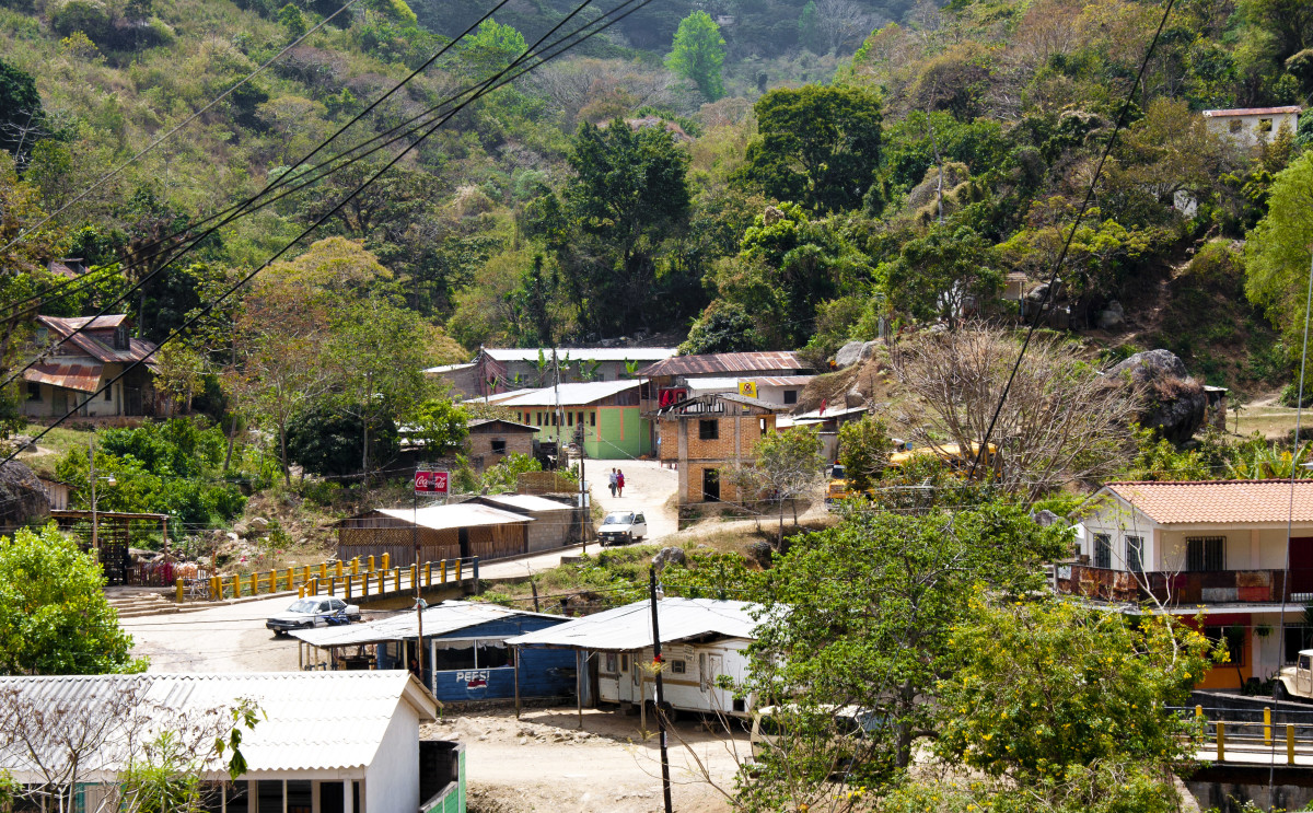 """Downtown"" San Juancito.  A couple little stores beside the yellow and blue bridge."
