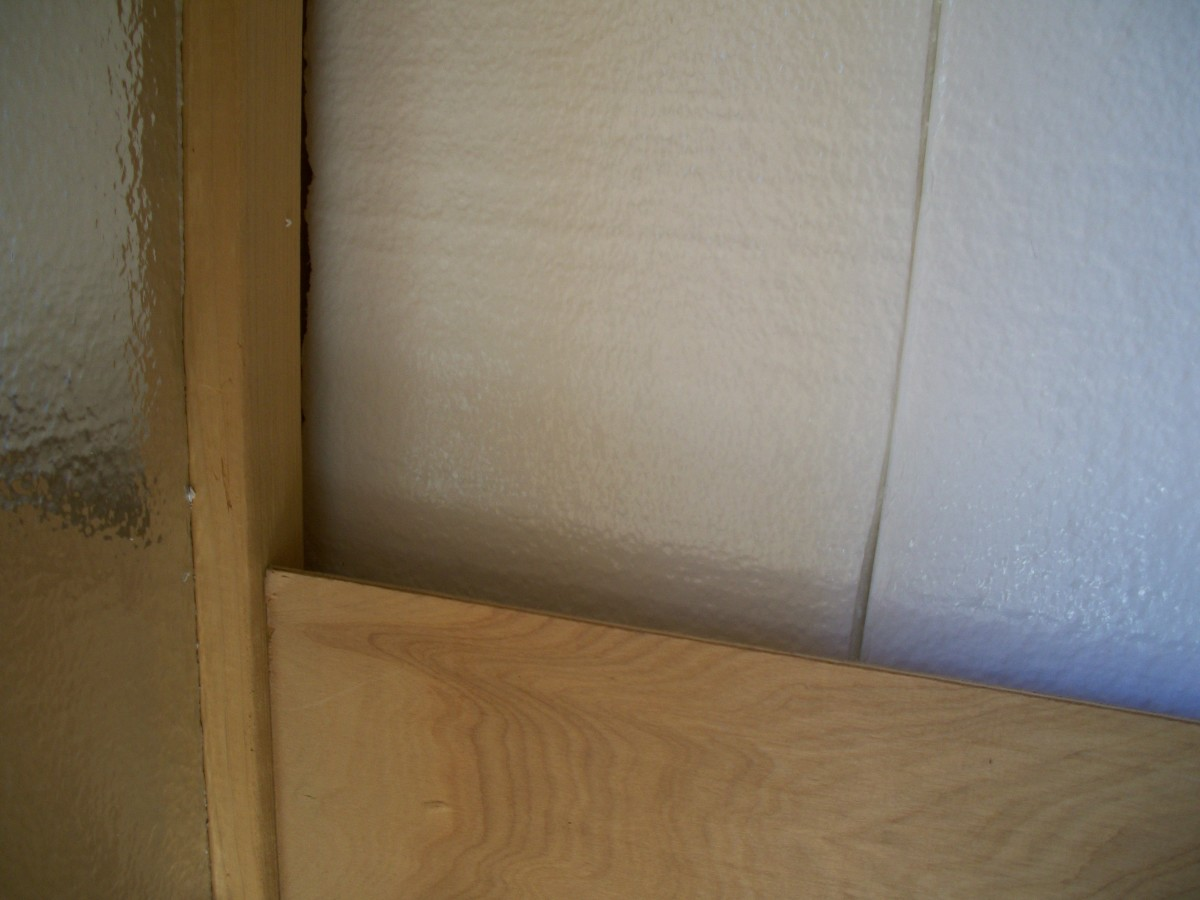 The interior corners were not laid out in a manner conducive to paneling.  There is nothing to fasten the side wall paneling to.