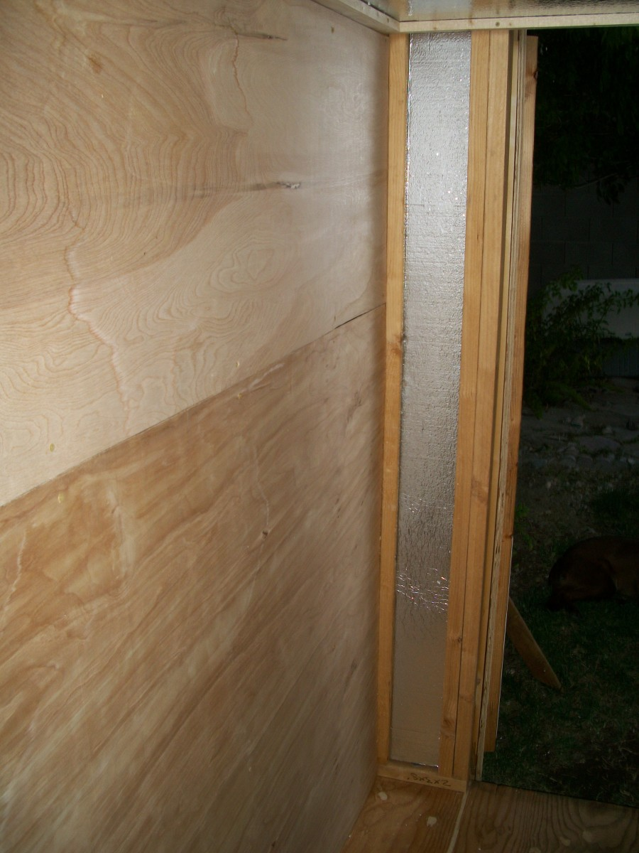 Paneling floor to ceiling on one side wall.