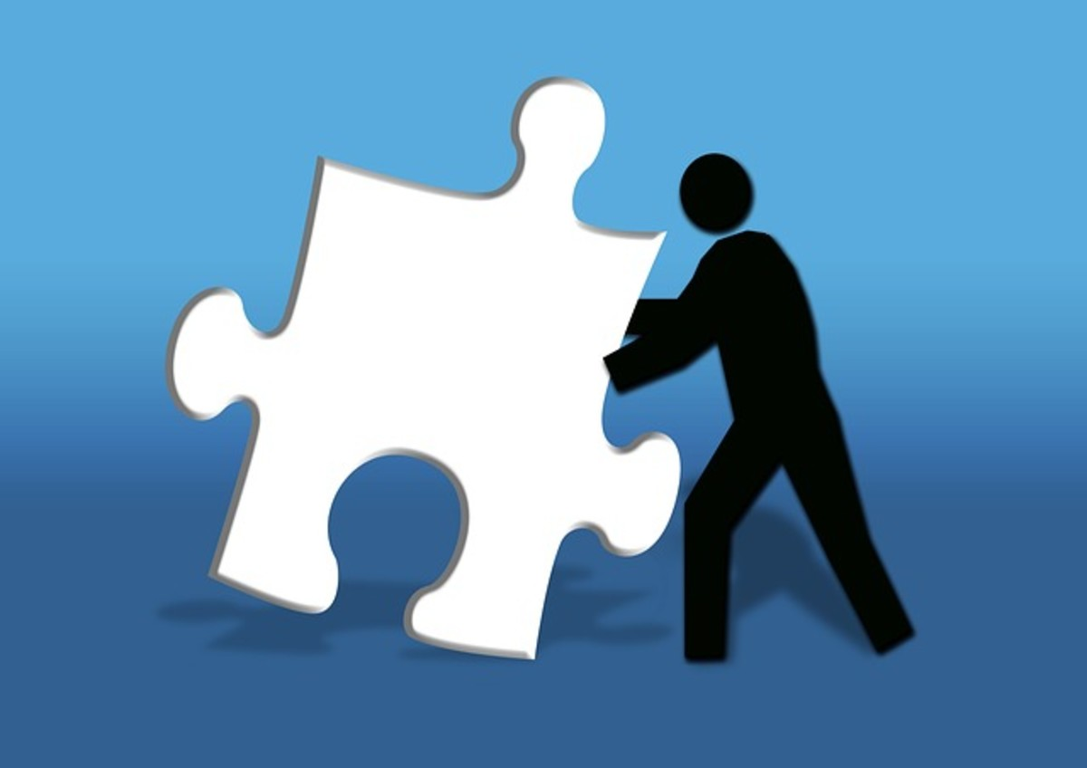 A man searches to place a puzzle piece where it will create a complete picture for him.
