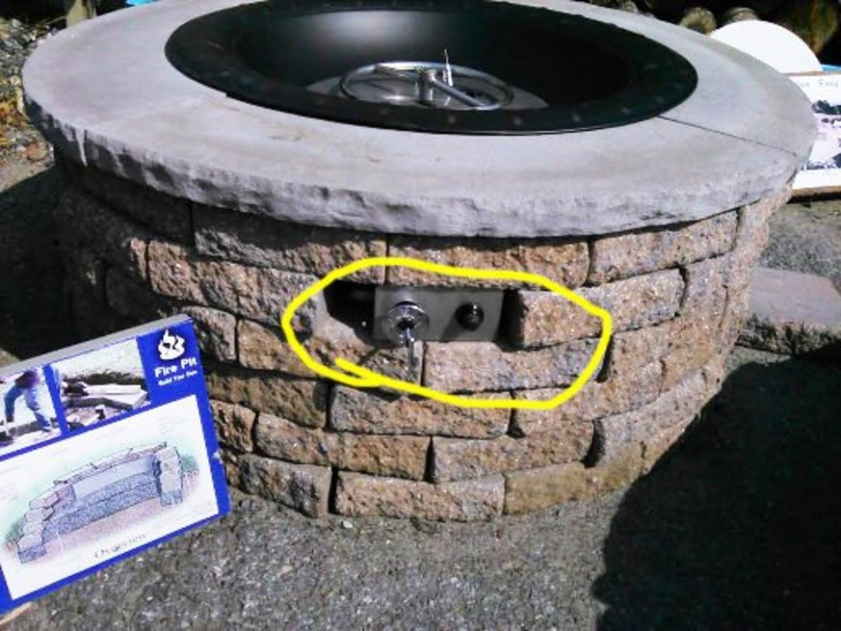 This photo shows the location of manual controls. In this case, there is a side opening with start and spark controls.