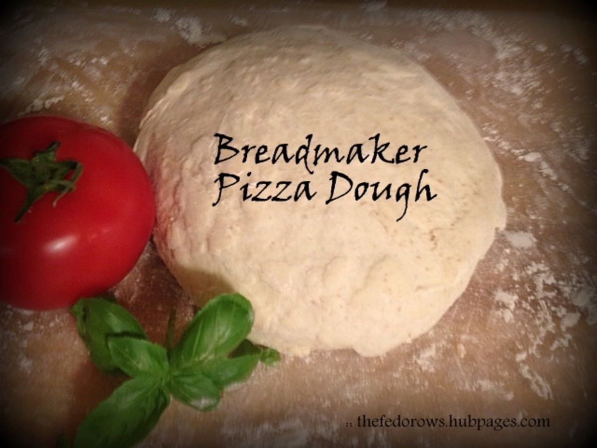 An easy bread-maker pizza dough recipe that can be used for pizza, personal calzones, and stromboli. Soft and chewy on the inside, crispy on the outside! Will make your house smell like a pizzeria!