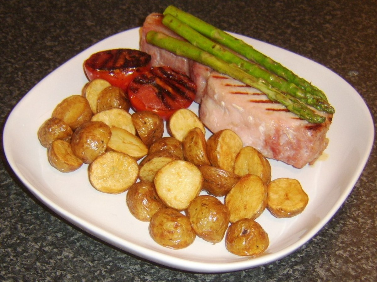 Griddled back bacon steak with asparagus and pan roasted baby potatoes
