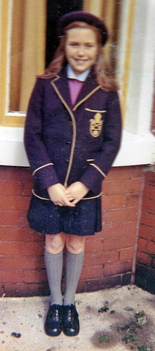 Shy child: Me at the age of eleven years, posing in my school uniform as I prepared to start secondary school - a private school for girls.