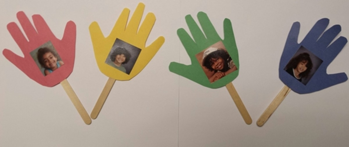 """These traced-hand photo displays can be """"planted"""" in small pots of dirt or marbles to resemble flowers."""