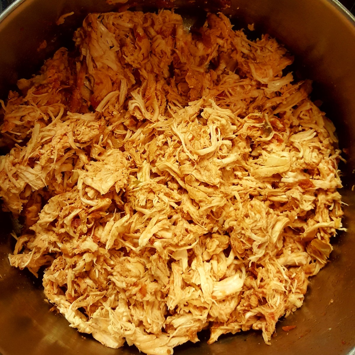 Easy Slow Cooker Shredded Chicken in Salsa for Tacos, Nachos, & Burritos