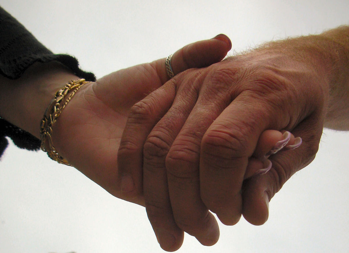 A couple holding hands signifies good companionship that can last a lifetime.