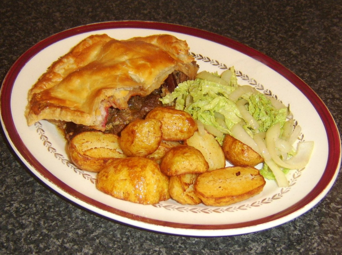 Steak, beetroot and Stilton pie is served with pan roasted potatoes and braised Savoy cabbage