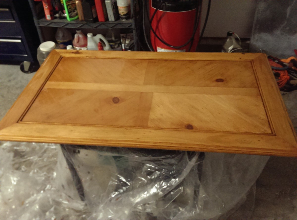 the second layer of stain! makes the table a little darker, but still not the color I want. After sanding, time to add a third coat!
