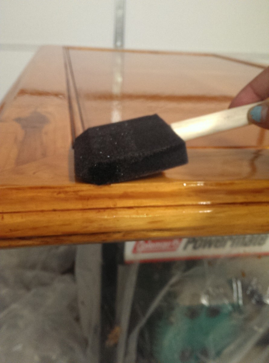 to prevent bubbles, use the flat side of the brush at a low angle and lightly but steadily drag the brush across the surface of the wood.