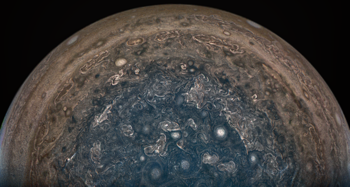 Jupiter's south pole is featured in this 2017 image taken by the Juno mission from about 63,000 miles above the cloud tops.