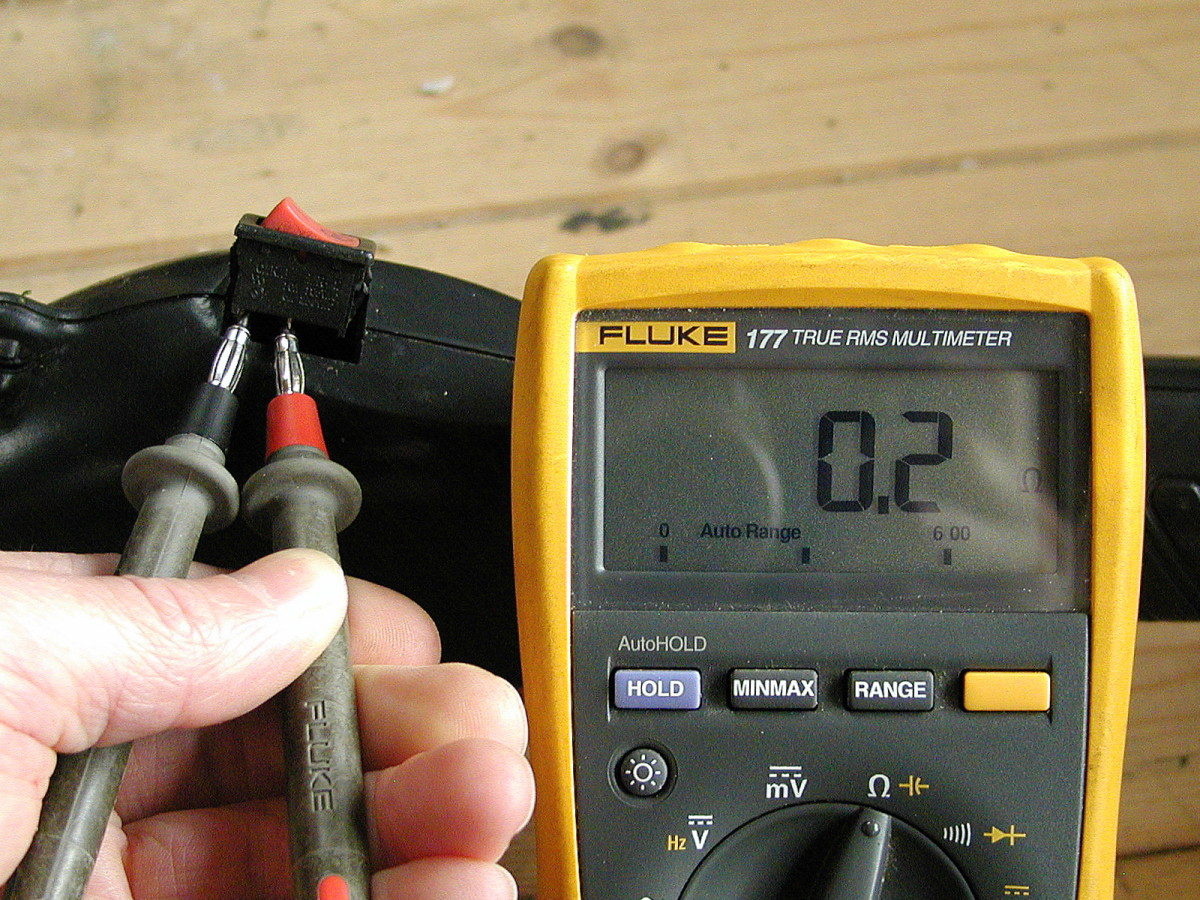 "Set the meter to the ""ohms"" range. Resistance should be less than 1 ohm with the switch in the off position. Ideally you should detach one of the wires from the switch when testing."