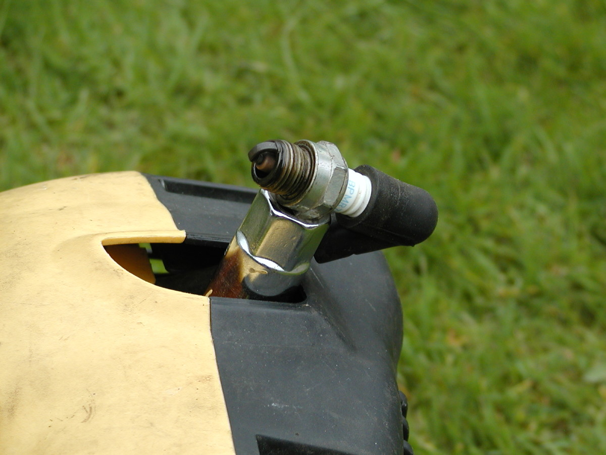 Use a socket or whatever to make contact with the body of the engine when testing for a spark.