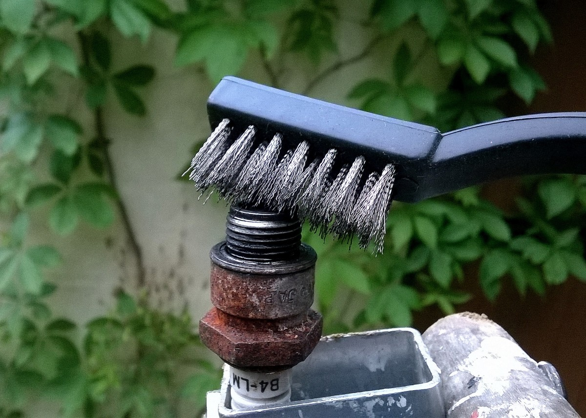 "A ""toothbrush"" style wire brush is useful for cleaning soot from a spark plug."